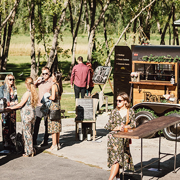 Outdoor event being served by vintage mobile bar